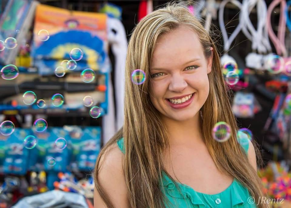 A cute girl at the fair by Joe Rentz